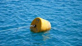 Summer, sea, in transparent bluish water floats orange buoy stock video footage