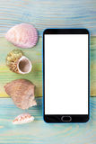 Summer sea vacation mockup background. Blank screen mobile sell smartphone tablet pc page with Travel items on blue Stock Photo