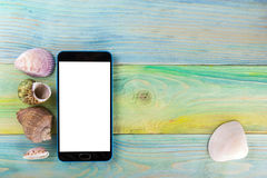 Summer sea vacation mockup background. Blank screen mobile sell smartphone tablet pc page with Travel items on blue Royalty Free Stock Image