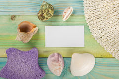 Summer sea vacation mockup background. Notebook blank page with Travel items on blue green wooden table. Sea shells Stock Photography