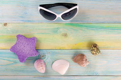 Summer sea vacation mockup background. Notebook blank page with Travel items on blue green wooden table. Sea shells Royalty Free Stock Photo