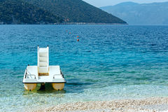 Summer sea view of Antisamos beach and catamaran. Stock Photography