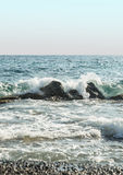 Summer sea water with rocks and waves Royalty Free Stock Photos