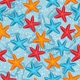 Summer seamless pattern with starfish on blue royalty free stock photography
