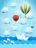 Summer seascape with hot air balloons and paper boat Stock Photos