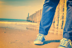 Summer seascape with relaxing teenager Stock Images