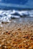 Summer seashell beach. With waves Stock Photos