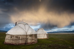 During the summer season Kyrgyz nomads put their yurts  at Song. A yurt is a portable, bent dwelling structure traditionally used by nomads in the steppes of Royalty Free Stock Photos