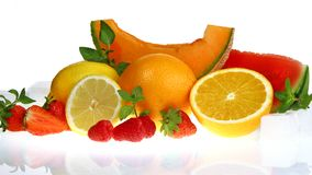 Summer season mixed fruit on white background. Original photo on the mirror surface stock photography