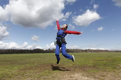 Girl is having fun before skydive jump. stock image