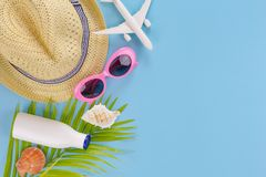 Summer set top view,outfit and accessories of traveler on blue Royalty Free Stock Photo