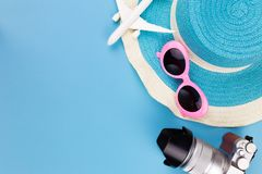 Summer set top view,outfit and accessories of traveler on blue Stock Images