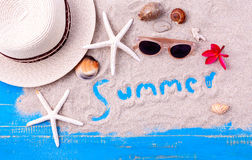 Summer setting up on wooden panel Royalty Free Stock Image