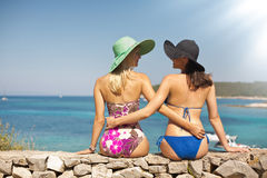 Summer shapely girls on the beach Royalty Free Stock Images