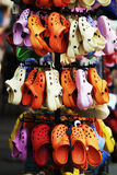 Summer shoes. Lot of hanging summer shoes in one open  street market Royalty Free Stock Photo