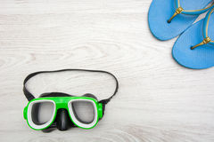 Summer shoes and snorkel on wood Royalty Free Stock Image