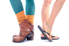 Summer shoes and winter shoes Stock Photography