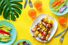 Hawaiian chicken grilled kabob summer concept. Summer simple recipe for grilling, hawaiian chicken kabobs served with freshly diced vegetables and some orange Stock Image