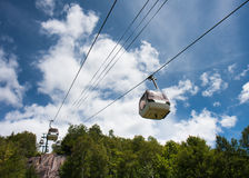 Summer ski lift. Ski lift against a cloudy blue sky Stock Images