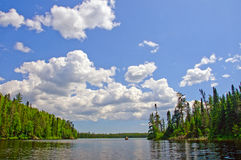 Summer Skies in Canoe Country. Summer Day on Rib Lake in the Boundary Waters royalty free stock image