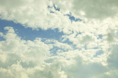 Summer skies and clouds in the UK. A few cumulus clouds, blue skies and warm weather royalty free stock images