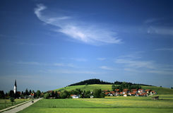 Summer sky. Landscape in the German Allgaeu, at morning, in summer and bright sunshine stock images
