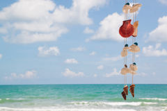 Summer sky and beautiful beach with hanging seashells. Summer sky and beautiful beach Royalty Free Stock Image