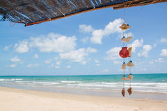 Summer sky and beautiful beach. With hanging seashells Stock Images