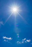Summer sky with bright shining sun stock images