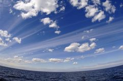 The summer sky over lake. Stock Photography