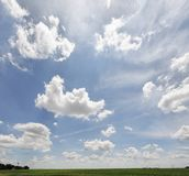 Summer sky in a rural setting. Summer skies with clouds moving across rural agricultural farm land stock photography