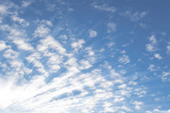 Summer sky with small Altocumulus clouds and bright sunrays sunb Stock Photography