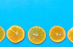 Summer of slice orange fruit on blue background stock photo