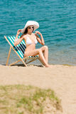 Summer slim woman sunbathing in bikini deckchair Royalty Free Stock Photos