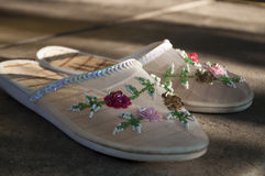 Summer slippers with multi colored flowers on it Royalty Free Stock Photos
