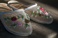 Summer slippers with multi colored flowers on it Stock Image
