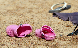 Summer slippers in sand Stock Photos