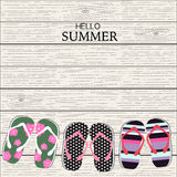 Summer slippers with wood linear background Stock Photo
