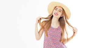 Summer smiling beautiful girl in summer hat studio portrait. Isolated royalty free stock photo