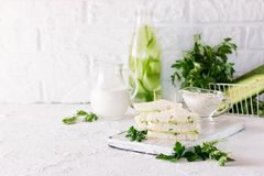 Summer snack mini sandwiches with cucumber and yogurt sauce. Summer snack three-layer sandwich with cucumber and yogurt sauce with parsley stock image