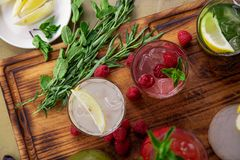 Summer soft drinks, a set of lemonades. Lemonades in jugs on the table, the ingredients of which they are made are. Arranged around stock photography