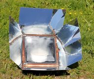 Summer solar cooking Stock Photo