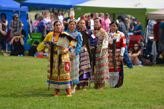 Summer Solstice Aboriginal Arts Festival. Teenage girls stand before judges after performing traditional dance in Summer Solstice Aboriginal Arts Festival for Royalty Free Stock Images