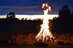 Summer solstice celebration in Latvia. Summer solstice celebration in Latvia, `Ligo` firewood on a midsummer night stock photo