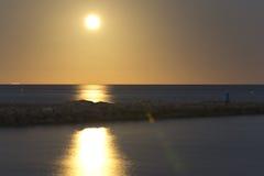 Summer Solstice full moon. Santa Pola; Alicante, Spain. June 21, 2016: Summer Solstice full moon reflected on the beach Gola, Santa Pola, Spain royalty free stock images