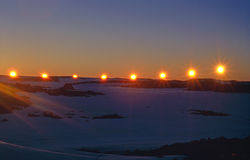 Summer Solstice Sunset at the Antarctic Circle. A time-lapse photo of the sun at mid-night on mid-summer day at Casey Station Antarctica Royalty Free Stock Images