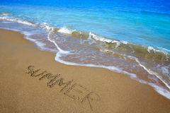 Summer spell written word in sand of a beach Royalty Free Stock Images