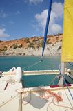 Sailing Catamaran with yellow sails in Ibiza Spain. Summer sport activity going sailing on a catamaran in Cala d'Hort, Ibiza Spain Stock Photography