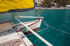 Sailing Catamaran with yellow sails in Ibiza Spain. Summer sport activity going sailing on a catamaran in Cala d'Hort, Ibiza Spain Stock Image