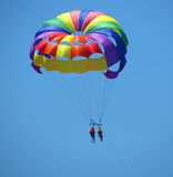 A summer sport - colored parasailing Royalty Free Stock Photo